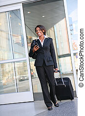 Traveling Business Woman - An attractive african american...