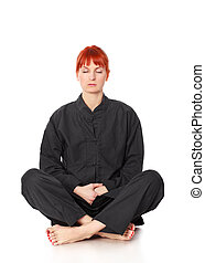 Wushu Woman Meditation - girl in black kimono siting and...