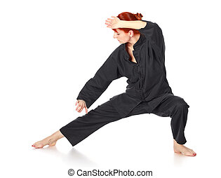 Wushu Woman - girl in black kimono exercise, isolated on...
