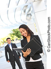Pretty Business Woman Reading - A beautiful African American...