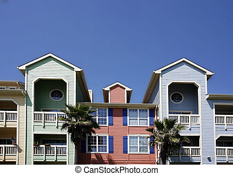 Colorful apartments condo on blue sky background