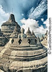 Borobudur - Buddha statue in stupa. Borobudur. Java....