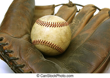 Ball and Glove - A vintage old time baseball glove holding a...