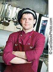 chef in uniform at kitchen
