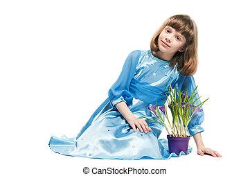 little girl with crocus spring flower - little smiling girl...