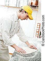 baker making dough for Pizza