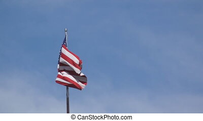 American flag is waving in wind