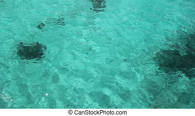 Travel over turquoise water. - View of shallow, turquoise...