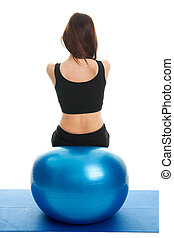 Fitness women exercising on fitness ball Shot from behind....