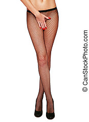 Fishnet stockings - Long slim legs of sexy tanned woman in...