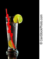 Drink with fresh lime and red straw