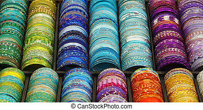 Colorful bracelets - Detail of a stand with various colorful...