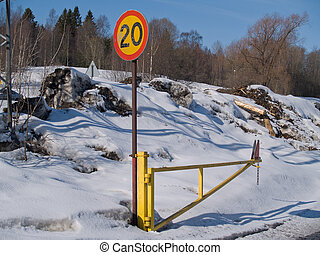 20 speed limit sign at winter road