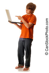 young teenage boy with laptop computer pointing towards...