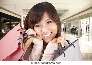 happy asian woman in a shopping mall
