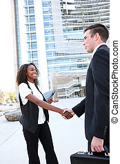 Diverse Man and Woman Business Team shaking hands at office...
