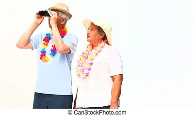 Elderly couple with binoculars