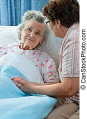 Care - Senior female is being visited by the daughter in...