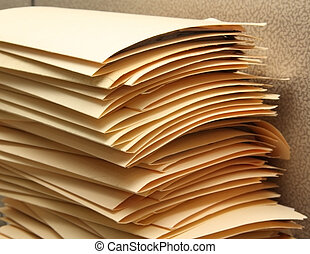 Paperwork - Manila folders piling up on a desk
