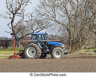 tractor in a plowed field