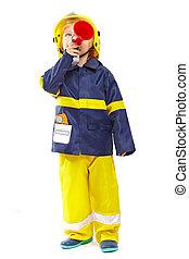 Little boy in fireman costume