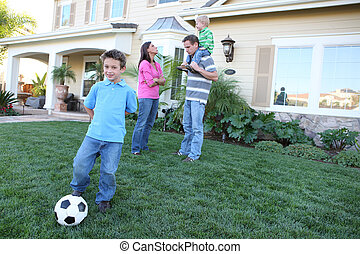 Happy Family at Home - A happy family having fun outdoors in...