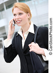 Pretty Business Woman on Phone - A redhead pretty business...