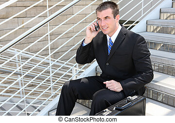 Handsome Business Man at Office - A handsome business man on...
