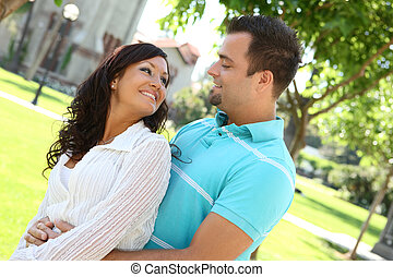 Sweet happy couple in love - A sweet happy couple in love at...