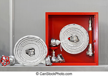 Fire hose - Hydrant with water hoses and fire extinguish...