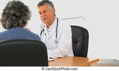 Doctor talking with his female pati