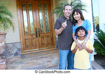 Happy Family at Home - Attractive happy family outside their...