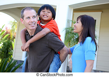 Asian Family at Home - Attractive asian family outside their...
