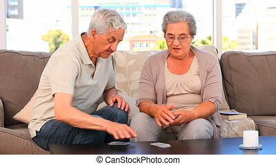 Mature couple playing cards