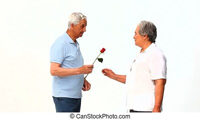 Man offering a rose to his wife
