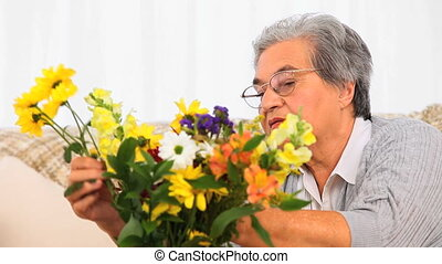 Senior woman making a brunch flowers