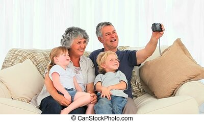 Family taking a picture about themselves