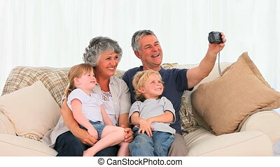 Family taking a photo about themselves