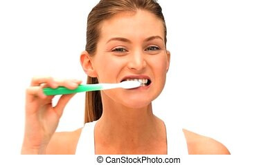 Woman brushing her teeths