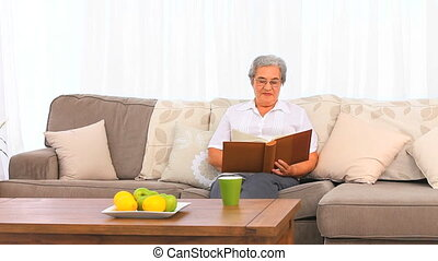 Woman looking at her photo album
