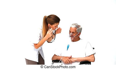 Nurse taking the hearbeat of her sick patient