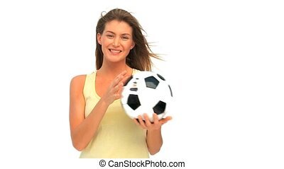Lovely woman with a ball of soccer