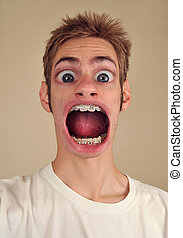 Screaming with Huge Mouth - A young man screaming with huge...