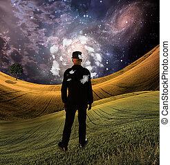 Mind of man - Man in field in fantasy landscape