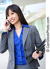 Asian Business Woman on the Phone - A young, pretty asian...
