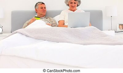 Retired couple buying something on the net