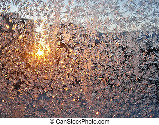 Hoar-frost on pane at sunset - winter background