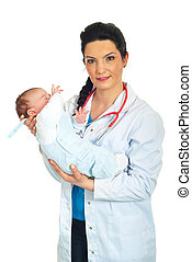 Doctor woman holding baby