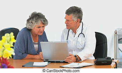 Woman looking at the laptop of her