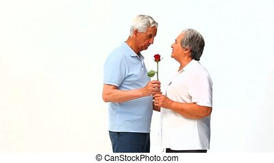 Man offering flowers to his wife